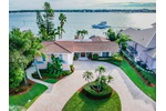 OPPORTUNITY AWAITS TO OWN THE IDEAL WATERFRONT HOME WITH THE MOST SOUGHT AFTER LOT IN ALL OF ISLAND ESTATES!